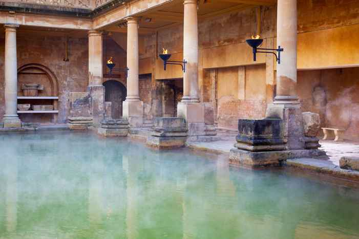 Steam rising off the hot mineral water in the Great Bath in the Roman Baths in Bath, England